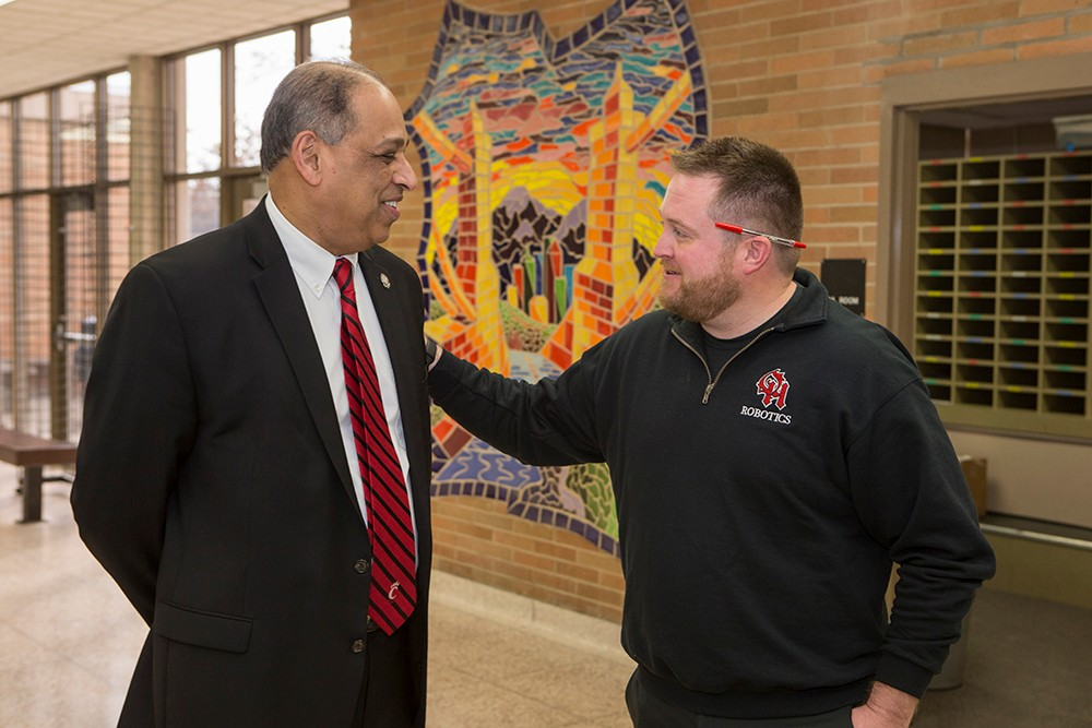 UC President Neville Pinto reconnects with his former student, Dan Boles. The 2003 UC graduate says Pinto was his favorite professor.
