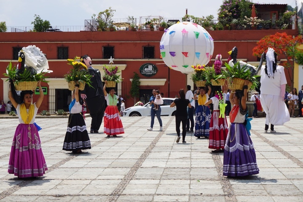 UC students enjoy a town festival with dancers in Oaxaca City, Mexico.