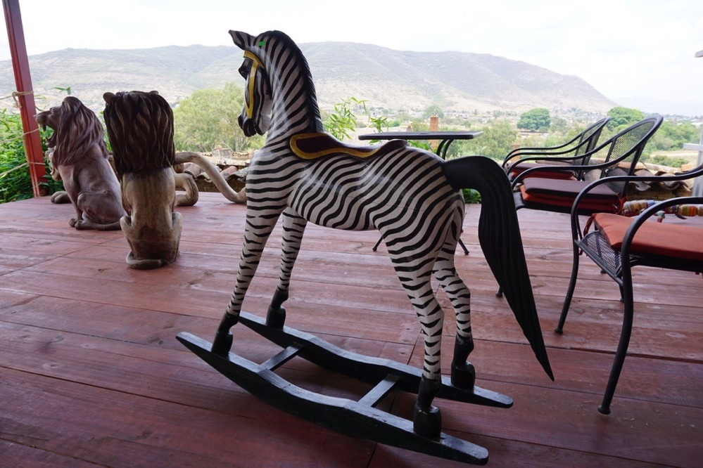 Wood carved zebra rocking horse made by indigenous artists in Oaxaca, Mexico.