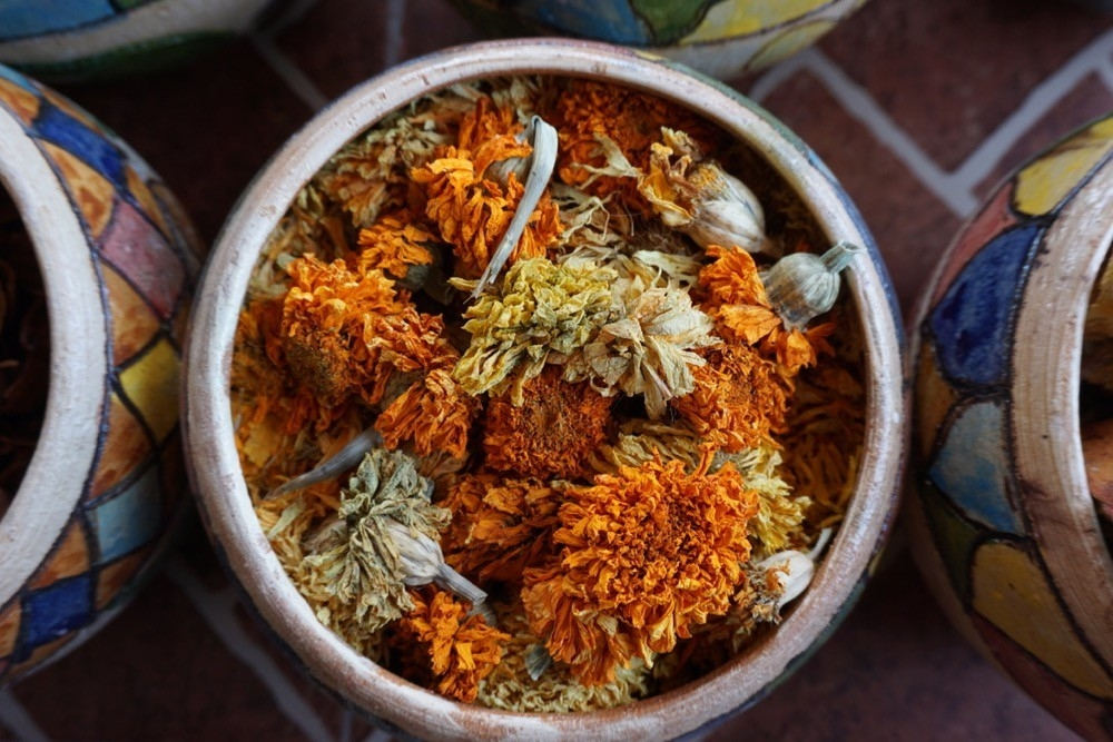 Large bowl of orange dried flowers used to make dye in Oaxaca, Mexico.