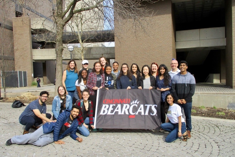 UC social justice & global health study abroad class stands together on campus before going to Oaxaca, Mexico.