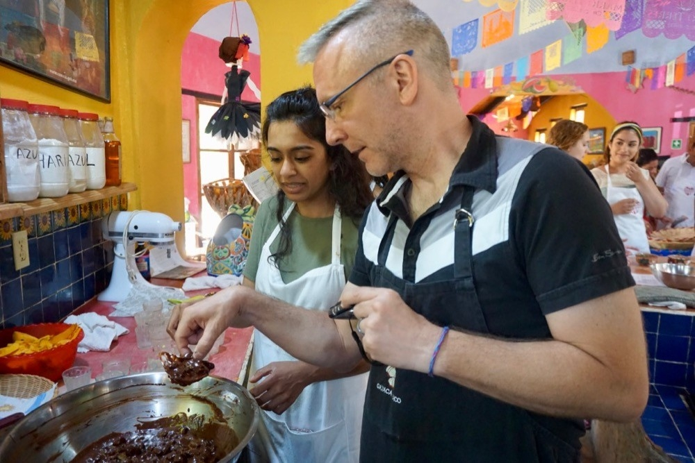 UC's Jason Blackard and his study abroad students enjoy a cooking class at the Season's of My Heart cooking school in Oaxaca, Mexico.