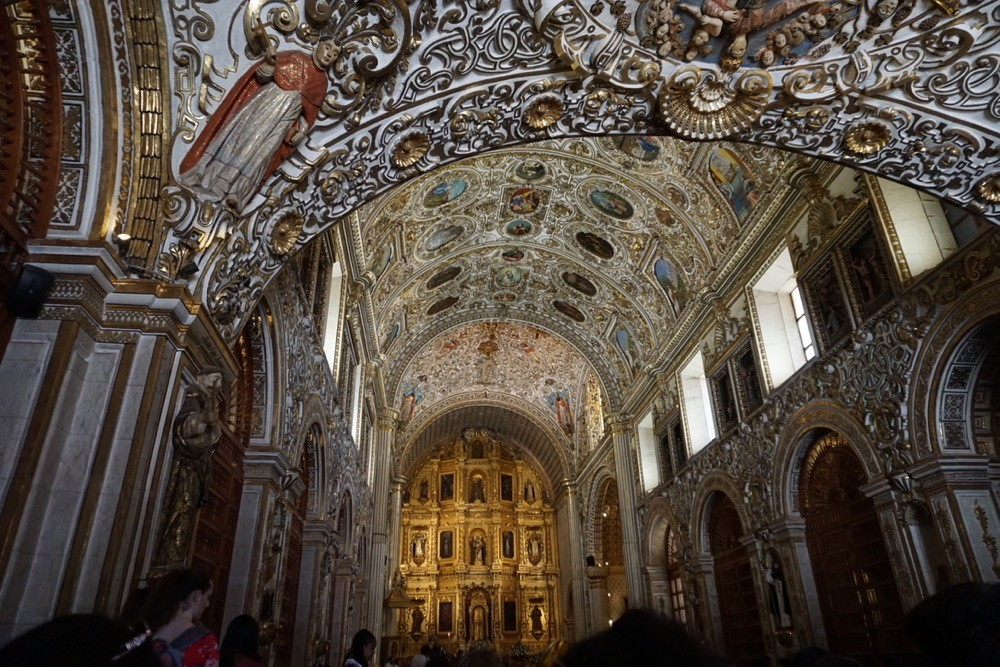 Ornate carved interior of a church in Oaxaca, Mexico.
