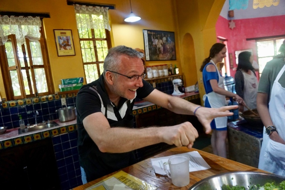 UC's Jason Blackard entertains students at a cooking class during a study abroad trip in Oaxaca, Mexico.