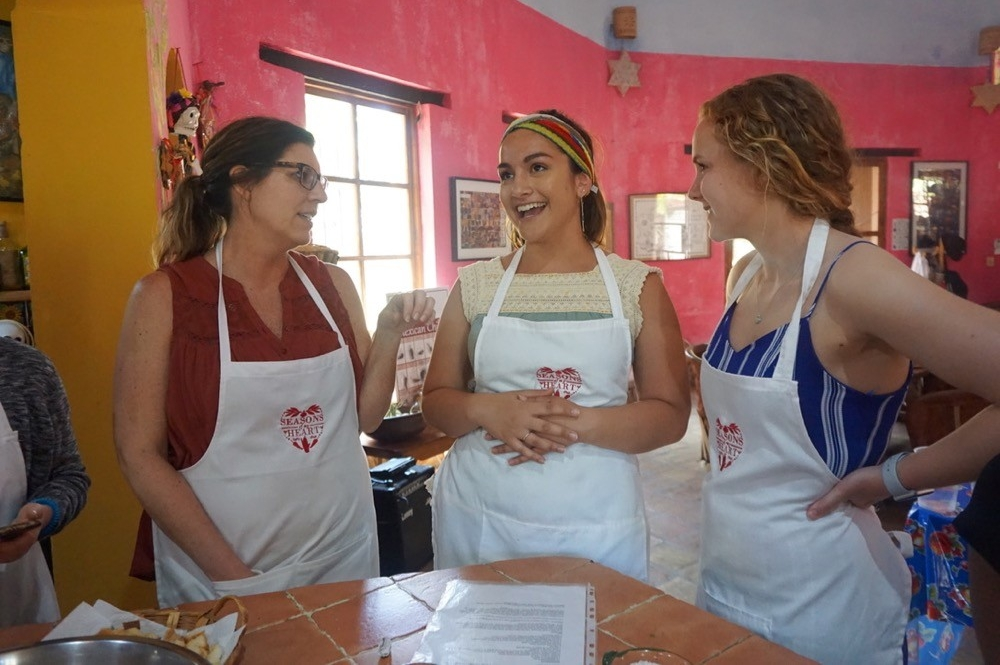 UC's Robin Selzer and her students enjoy a cooking class at the Season's of My Heart cooking school in Oaxaca, Mexico.