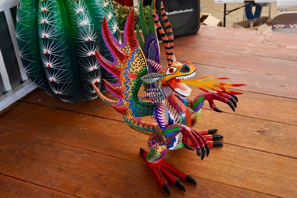 A colorfully painted wood sculpture of a dragon in Oaxaca, Mexico.