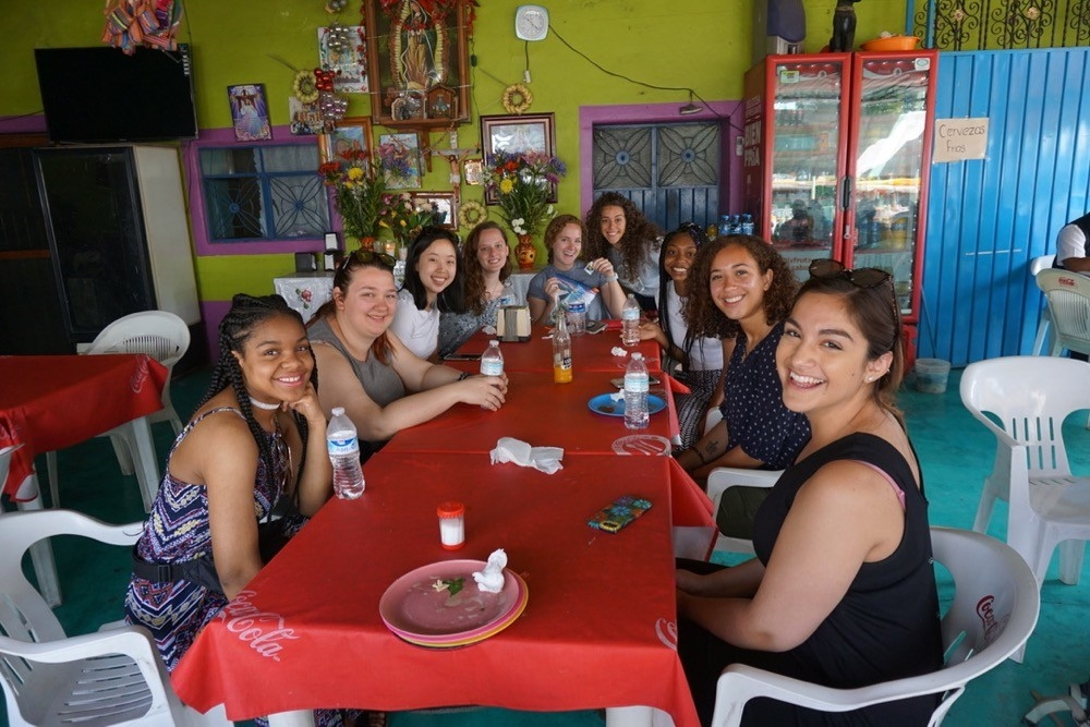 UC study abroad students sit together in a local restaurant in Oaxaca, Mexico.