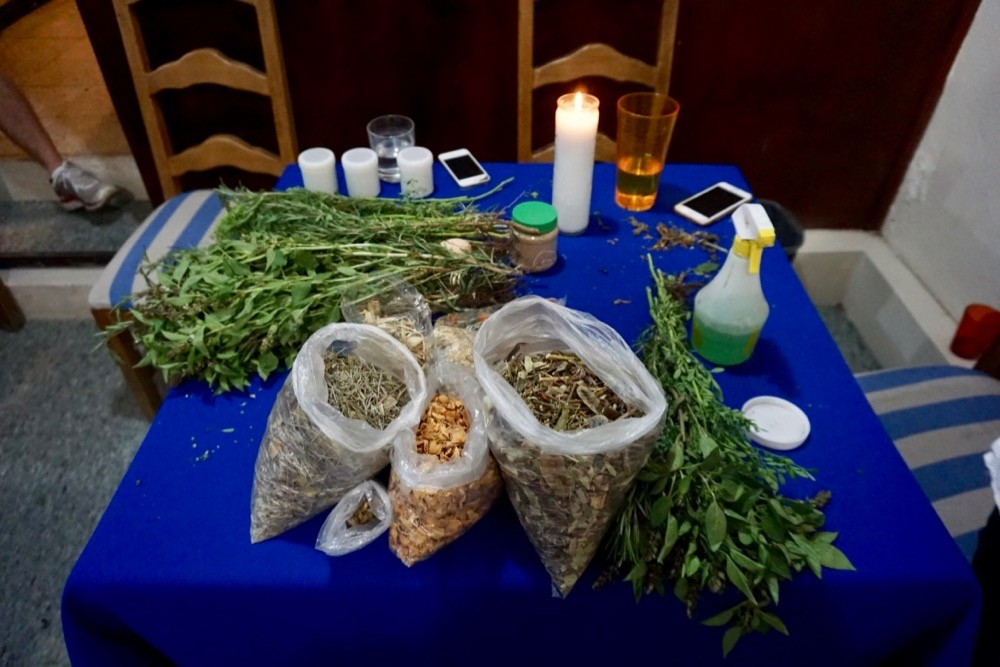 Several bags of herbs and plants on a table ready for an indigenous faith healing ceremony in Oaxaca, Mexico.