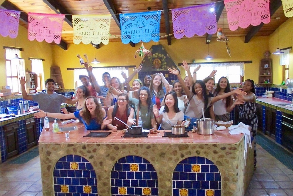 UC study abroad students stand together at the Seasons of My Heart cooking school in Oaxaca, Mexico.