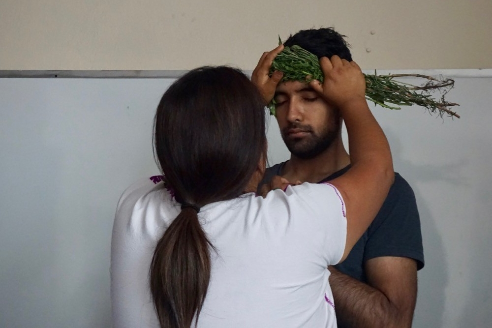 UC medical sciences student Rohan Srivastava is brushed on his forehead by a folk healer while on study abroad in Oaxaca, Mexico.