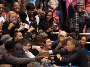 Barack Obama reaching to shake hands at the November 2012 rally on campus.