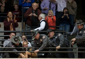 UC police remove a heckler at the Obama rally in November 2012.