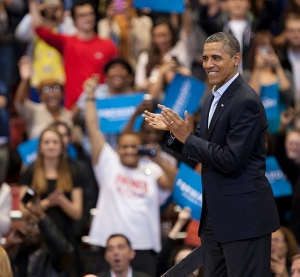 Obama clapping with the crowd at the Nov. 2012 rally