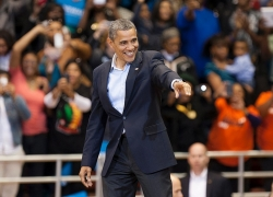 President Barack Obama pointing to someone in the crowd at Fifth Third Arena