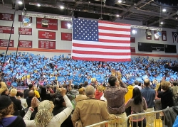 Blue campaign signs waving through Fifth Third Arena as the crowd waits for President Obama.
