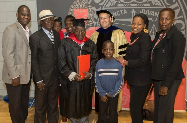 Samuel Ochiel Obura and his family attended UC's doctoral and master's commencement ceremony on May 1, 2015.