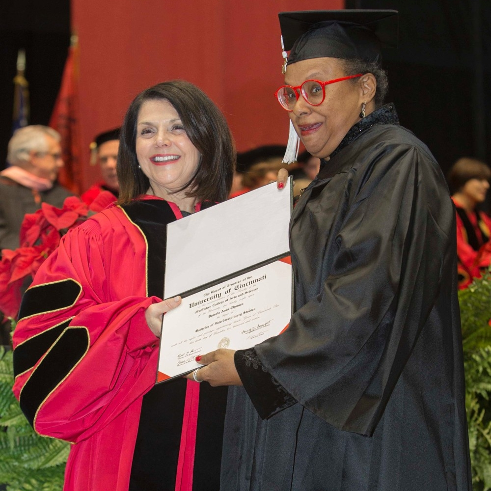 Pam Thomas stands with UC Interim President Beverly Davenport as she receives her bachelor's degree at UC graduation. photo/Joseph Fuqua II/UC Creative Services