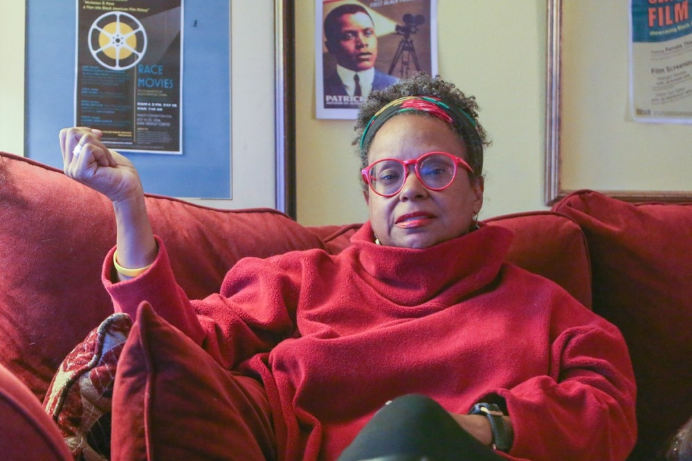 Pam Thomas sits on her sofa explaining her successful documentary film career. photo/Melanie Schefft
