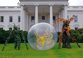 Posed on the front lawn of the white house are a vining Angel Noble, a winged Natalie Willes and a hardwood Todd Key -- all part of Philip Solomon's Halloween entertainment for the first family.