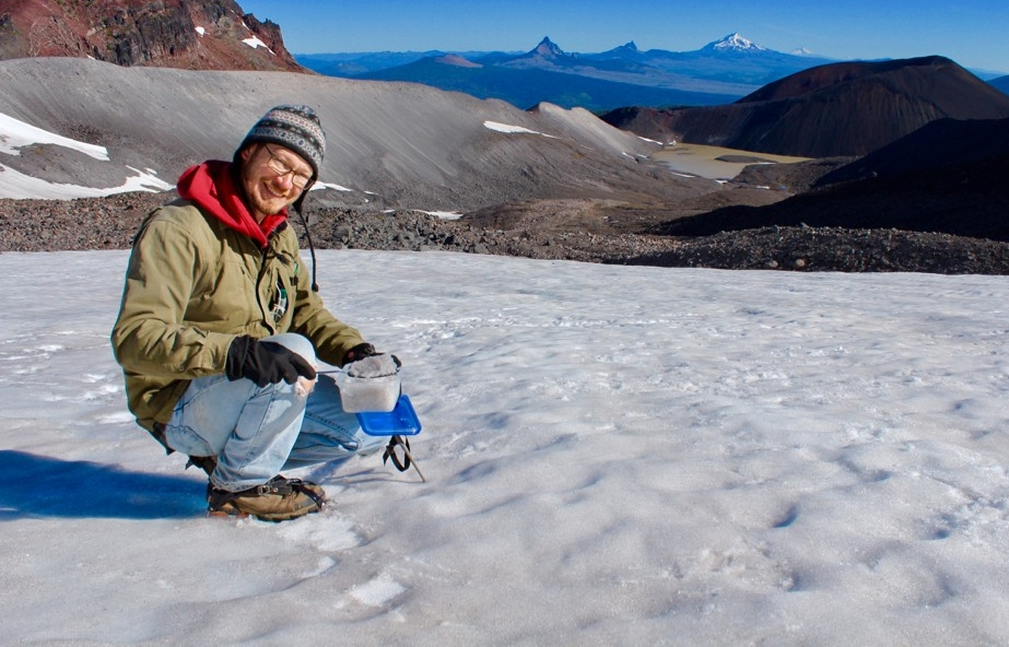Professor Jeff Havig collecting pink snow algae samples on Collier Glacier in North Sister, Oregon.