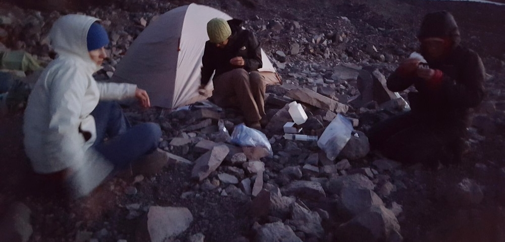 The Hamilton/Havig research team at a campsite at night on a volcanic peak in Oregon.
