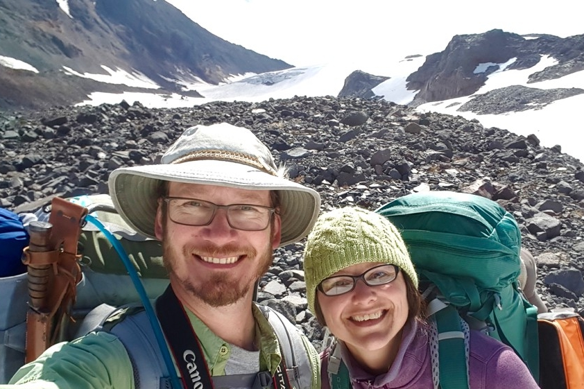 Professors Jeff Havig and Trinity Hamilton stand together on a volcanic glacier in Oregon