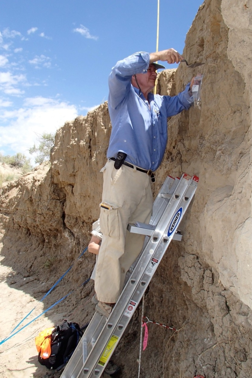 UC professor Nicholas Dunning on a ladder collecting sediment samples in Chaco Canyon, New Mexico.