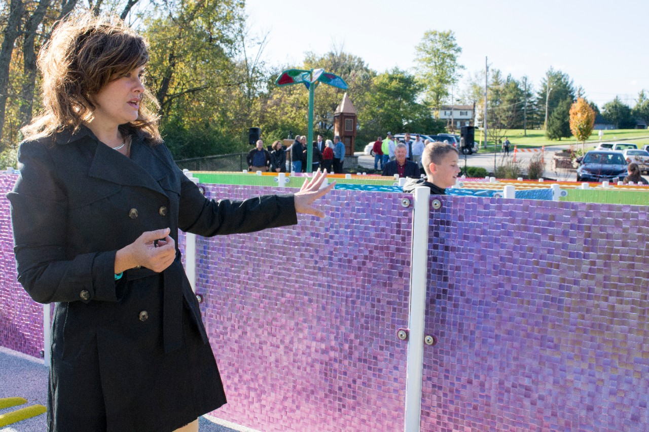 UC early childhood education professor Tina Stanton-Chapman explains the features of the new playground at West Fork Park.