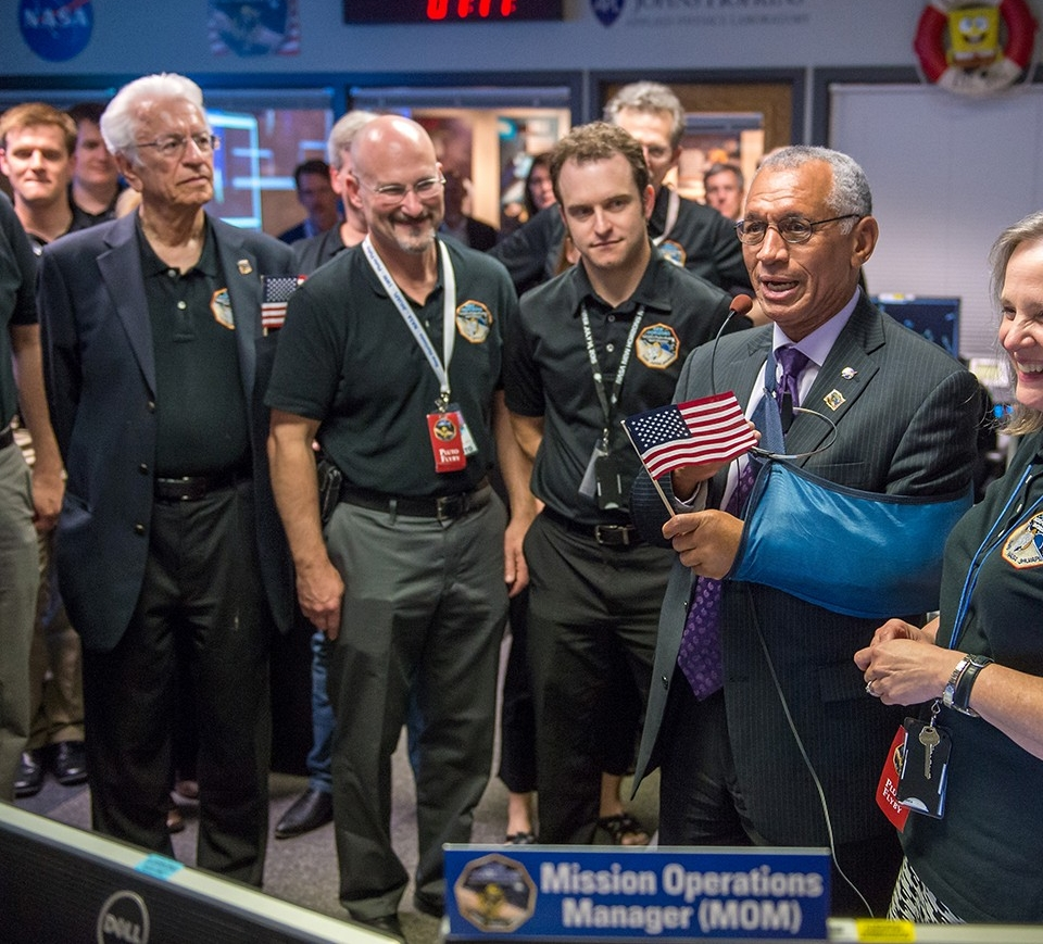 UC graduate Chris Hersman (smiling) celebrates the successful rendezvous of New Horizons with Pluto in 2015. (NASA)