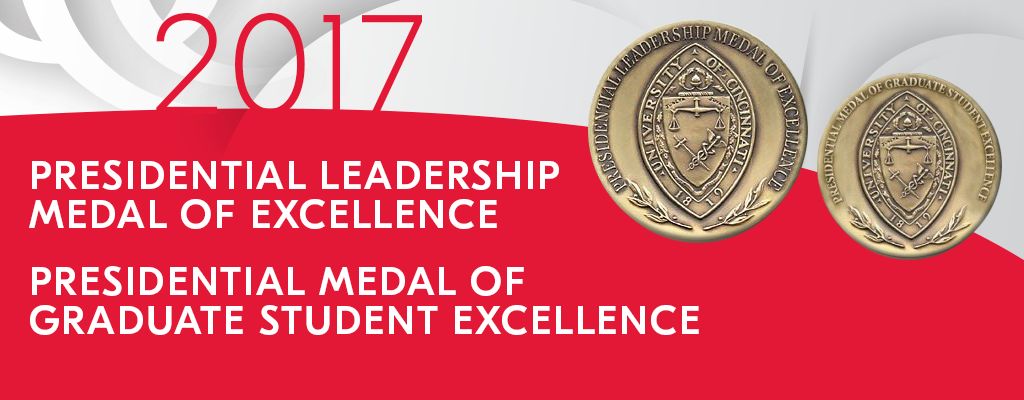 Two gold medals with red and black ribbon background in tribute to UC Presidential leadership medals of excellence