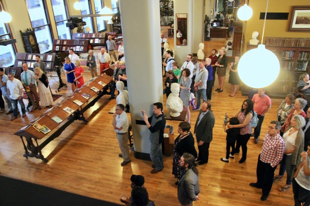 UC faculty, students and poetry lovers listen to the poetry of Manuel Iris inside the Mercantile Library.