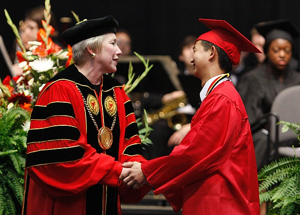 Dr. Zimpher congratulates UC student Jerry Tsai during the June 2008 commencement.