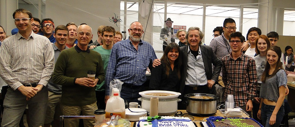 An impromptu potluck luncheon by industrial design students and faculty celebrates Interim School Director Brigid O'Kane and Dean Robert Probst.