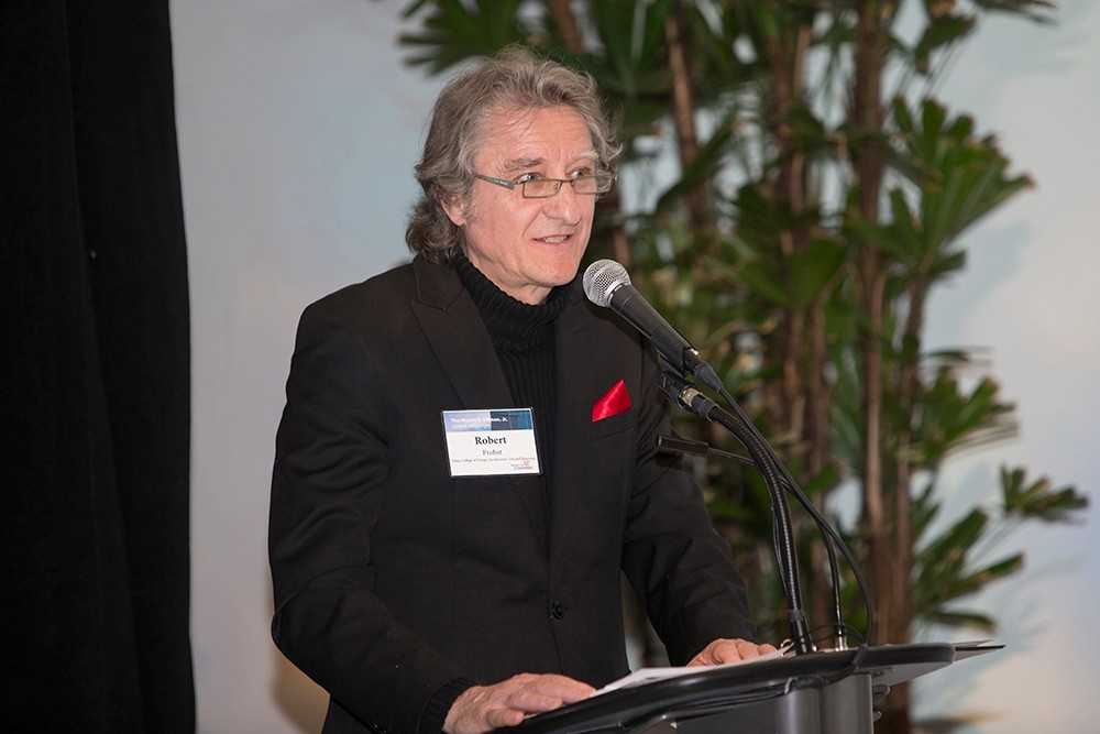 Wearing glasses and a black suit, Dean Robert Probst speaks at a podium during the Myron E. Ullman, Jr. School of Design naming event in April 2016.
