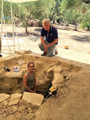 Jack Davis and Shari Stocker standing over an archaeological excavation site