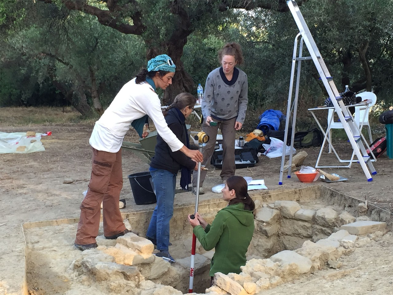 Team of archaeologists working over an excavation site