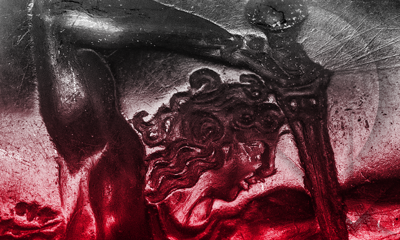 Close-up of a combat scene etched on a small gem stone