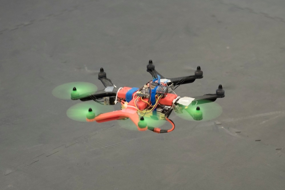 An octocopter drone hovers in UC's Aerospace Flight Lab.