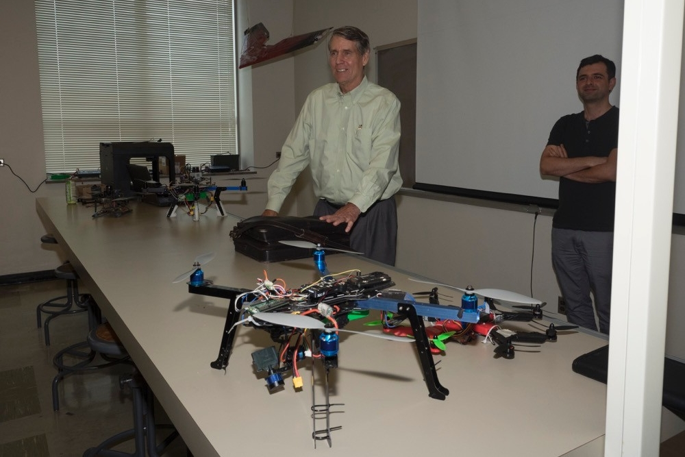 Larry Bennett, UC fire science explains the importance of FAA approval for flying drones to representatives from ODOT.
