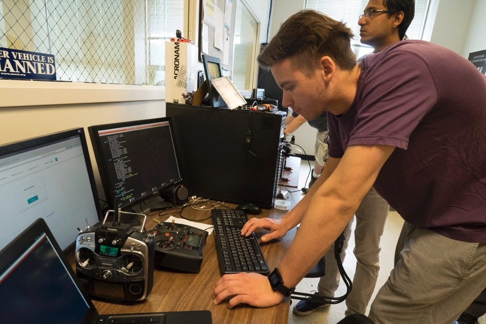 Students operate a UAV from a command center.