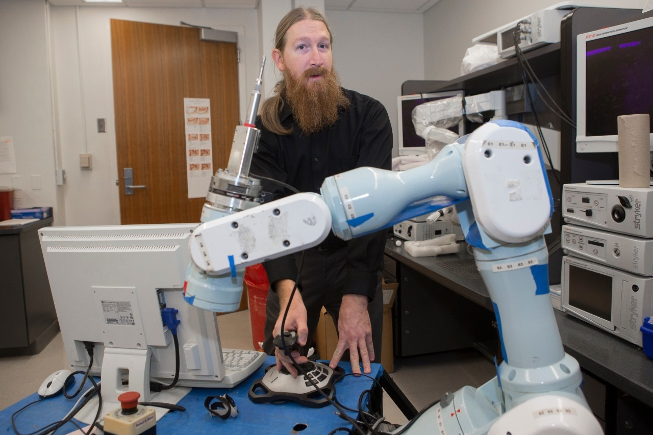 UC graduate student Christopher Korte is studying how to make surgical robots more autonomous. This would be useful in space exploration or simple, tedious medical procedures on Earth, he said.