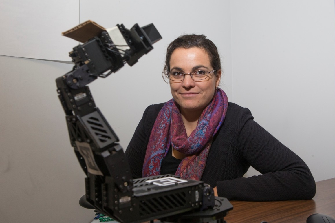 UC assistant professor Tamara Lorenz, who holds a joint appointment in psychology and mechanical and electrical engineering, is studying the interactions between humans and robots in her lab.