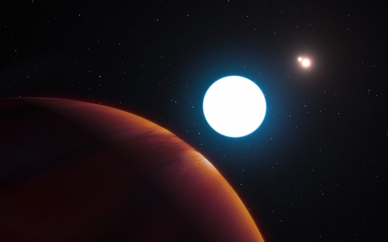 UC study-abroad group sit in a dark lava cave in Iceland wearing hard hats with headlamps.photo/Kevin Grace