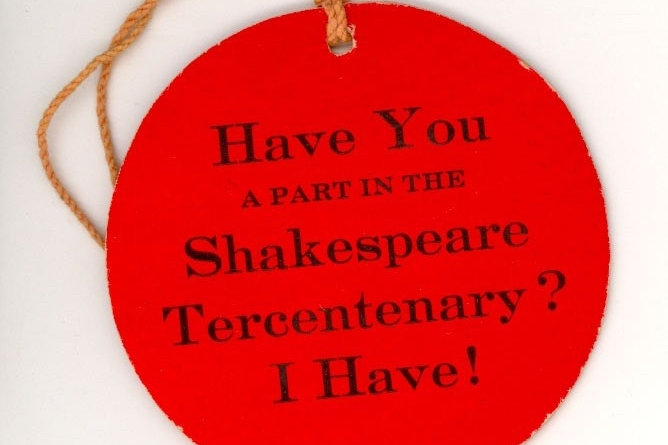 A round, red sign tag that reads, Have you a part in the Shakespeare Tercentenary? I have!