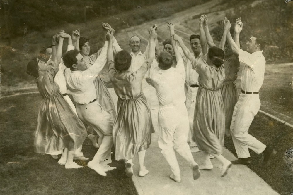 Group of UC English faculty dancing in Burnett Woods in 1916 for the 300th anniversary of William Shakespeare's death.