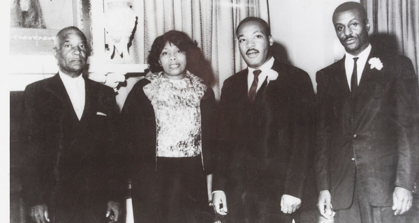 Standing and looking at the camera are Robert Shropshire Sr., Louise Shropshire, Rev. Martin Luther King Jr., Rev. Fred Shuttlesworth Sr.