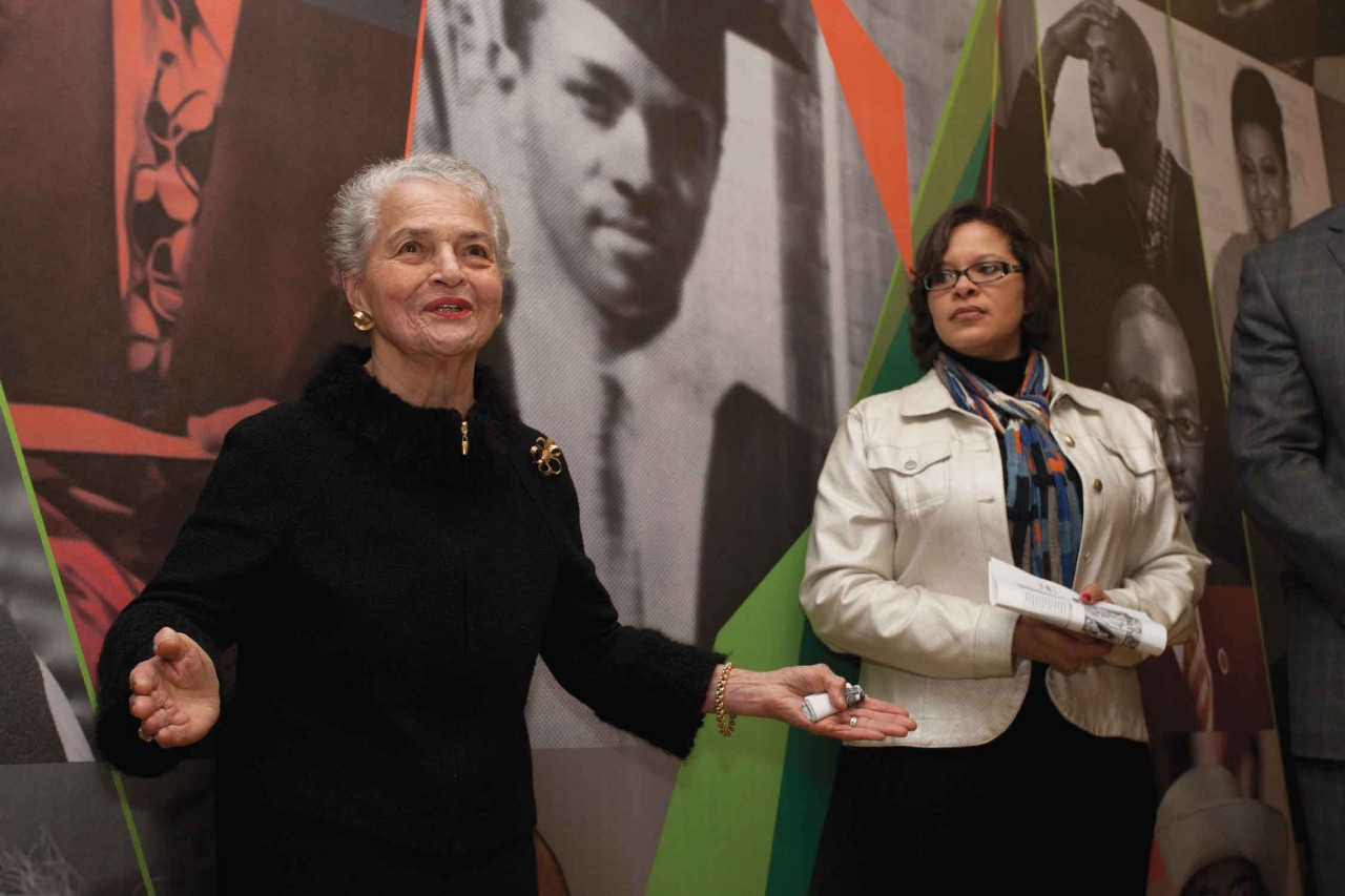 UC graduates Marian Spencer and Bleuzette Marshall stand inside UC's AACRC.