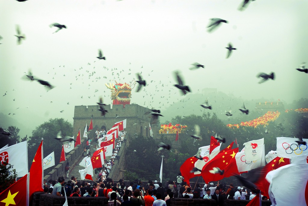 Flags wave as pigeons are released at the 2008 Beijing Olympics