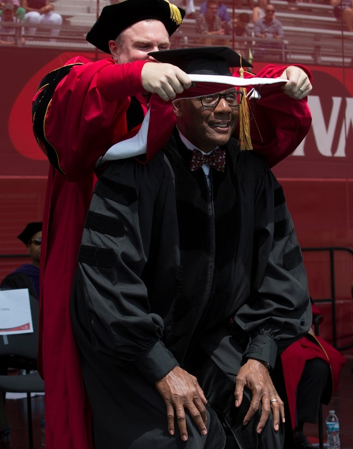 Lewis Johnson gets hooded as an honorary degree recipient