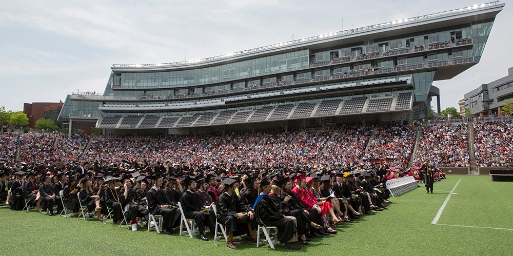 Graduates and guests fill Nippert Stadium for April 2017 Commencement